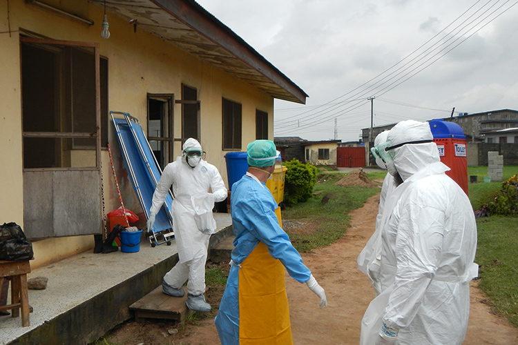 World Health Organization workers gearing up to go into old Ebola isolation ward in Lagos, Nigeria.