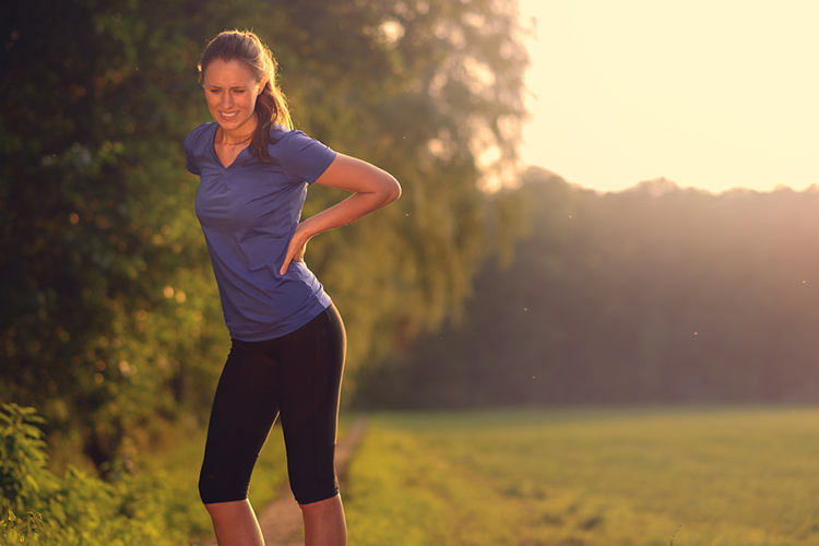 A nurse experiencing back pain whilst on a run.