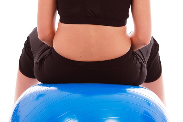 Back strengthening exercises using a swiss ball.