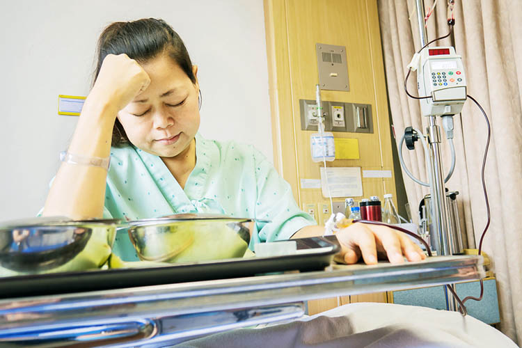 Disheartened patient during lunch   Image