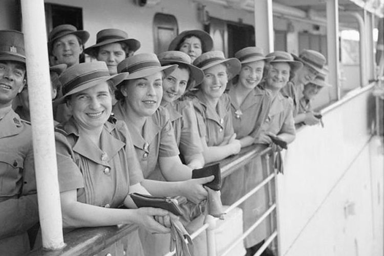 A group of Australian Army nurses wait to disembark from a hospital ship on arrival at Singapore