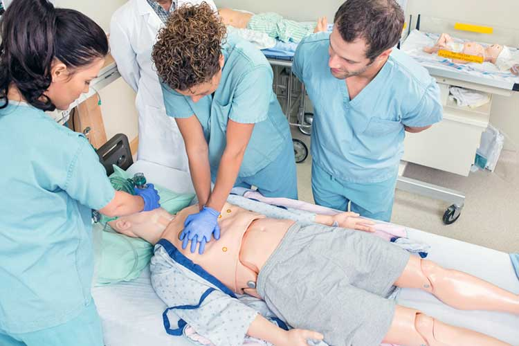 The Transition From Student to Registered Nurse practicing on dummy
