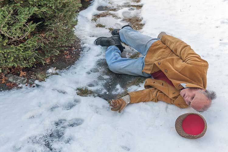 Elderly man who has slipped and fallen on ice | Image
